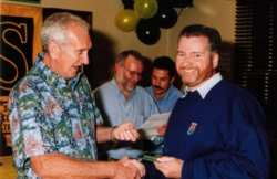 John Sprinzel presents 3rd in SCCA Driver's Championship trophy to Chris Dimmock, Sydney 2000
