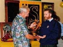John Sprinzel presents SCCA Associate Championship trophy to Chris Dimmock, Sydney 2000